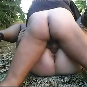 Masked chubby woman gives a blow job