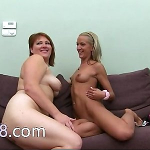 Two hot lesbians eating penis on couch