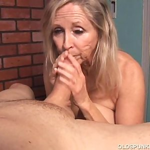 Beautiful blonde old spunker sucks cock and eats jism