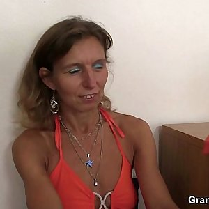 Horny granny takes two cocks
