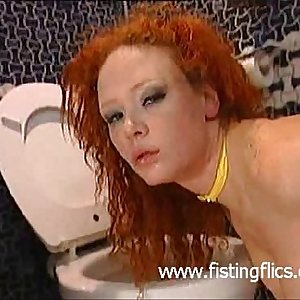 Redhead slut anal fisted and foot fucked in a dirty toilet