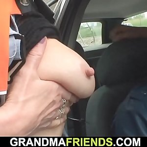 Old blonde woman dual penetration in the fields