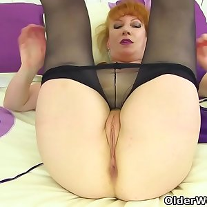 UK redhead mummy Velvetina toys her hairy and wet fanny