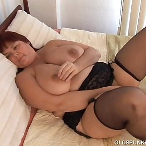 Beautiful chesty MILF in stockings