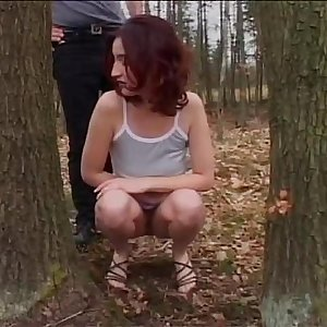 Beautiful and busty brunette buggered in the wood
