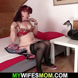 Brunette motherinlaw taking his shaft from behind