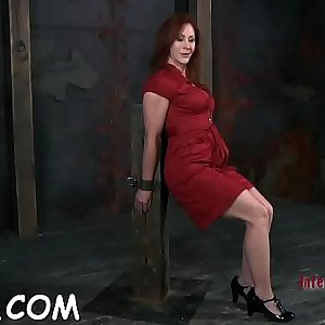 Cutie gets her pussy gratified while inside a cage