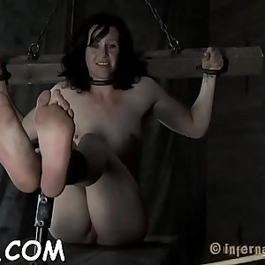 Gagged cutie is hoisted up before hard muff prodding